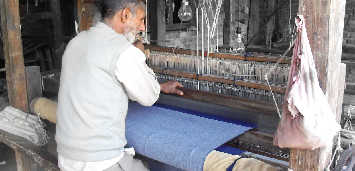 Artisan Weaving Selvedge Denim on Manually Operated Wooden Frame Handloom