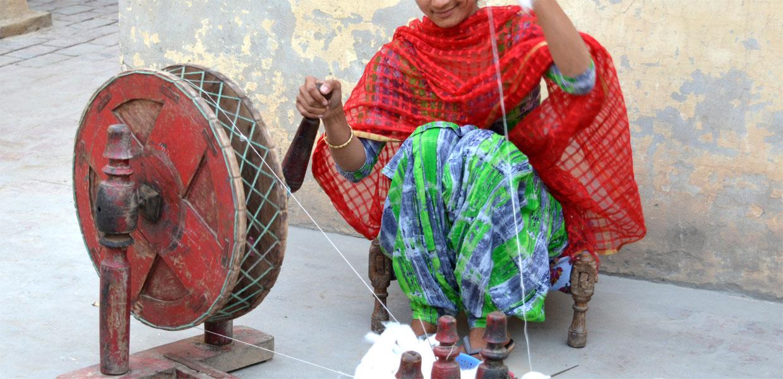 Lady Artisan Spinning Cotton Yarn by Hand on Charkha